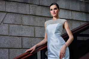 Straight cut porcelain white silk wool dress with an embellished yoke